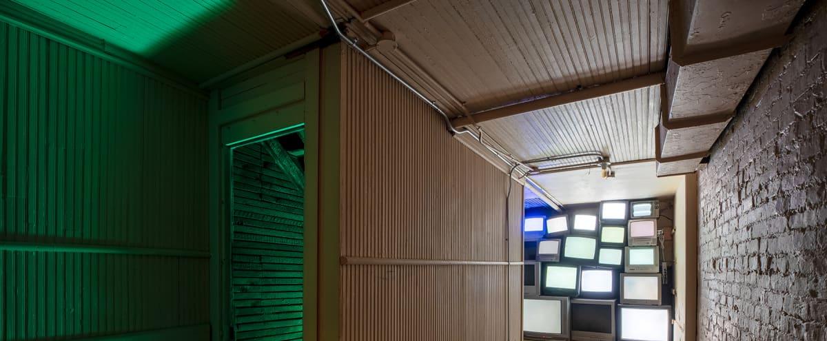 Classroom, TV Wall, Clock Stairway, Hall of Lamps, and Backyard in Brooklyn Hero Image in Bushwick, Brooklyn, NY
