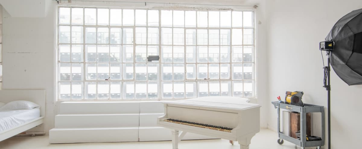 White Daylight Studio with Cyc wall, White Piano, large windows, White floors & Staircase  - Studio 1 in Long Island City Hero Image in Long Island City, Long Island City, NY