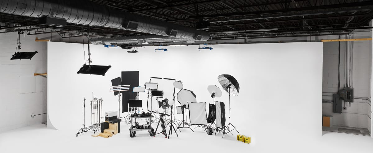Full Production Cyc Infinity Wall 5000sq ft Film and Photography Studio with 40' Cyc Wall and Cove, Garage Door to drive into Studio, Green Room, Hair and Makeup, Kitchen, Open Spaces in Louisville Hero Image in Phoenix Hill, Louisville, KY