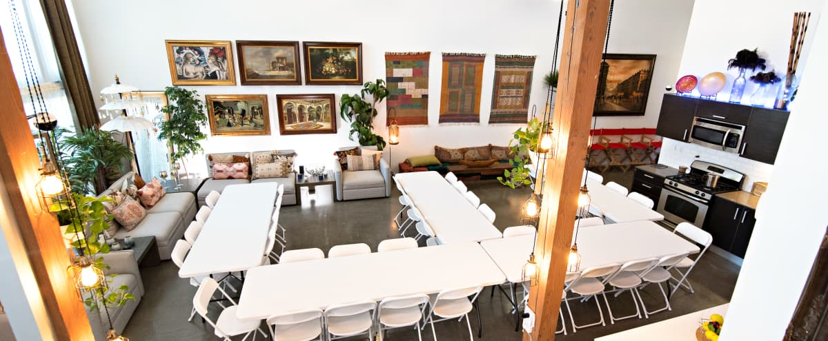 """2300 sq ft luxury studio loft w/ seating, office, 4K projector, private patio and 65"""" monitor in Los Angeles Hero Image in undefined, Los Angeles, CA"""