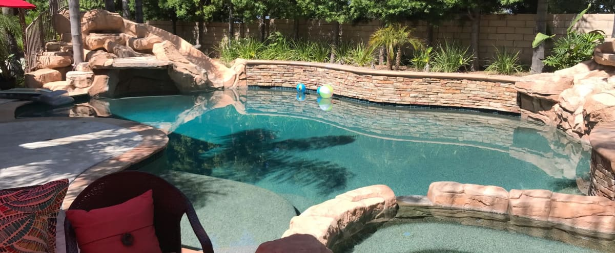 Larger slightly over the top pool with rock slide and 2 waterfalls and nice BBQ eating area in Mission Viejo Hero Image in undefined, Mission Viejo, CA