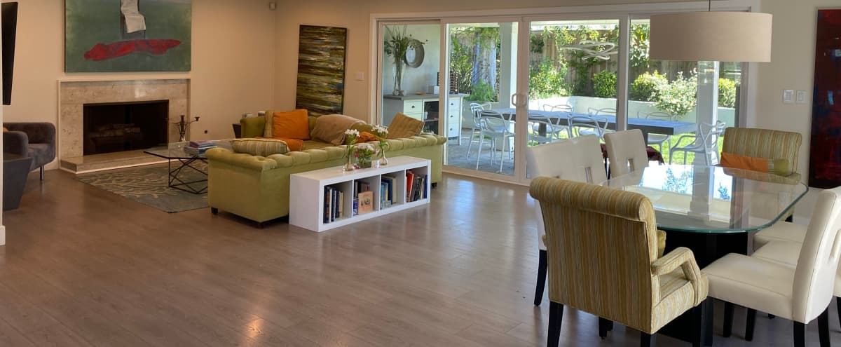 Open floor plan contemporary house in a suburban neighborhood.  Backyard has lots of trees and grass. in Newport Beach Hero Image in undefined, Newport Beach, CA