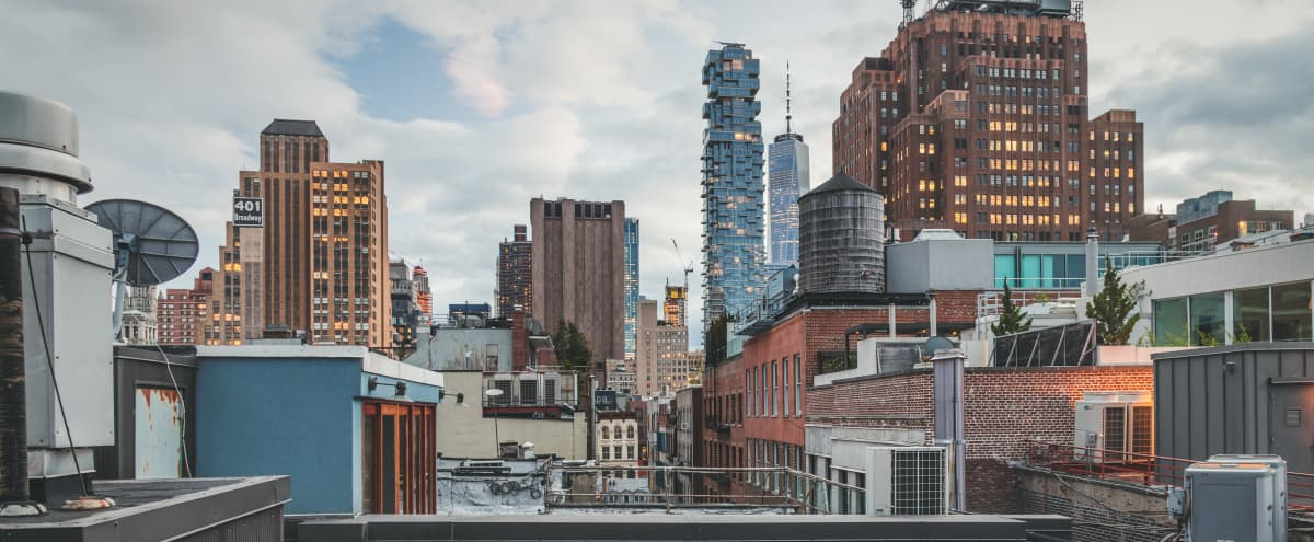 Conscious Designed Soho Apartment with Spacious Rooftop Access + views of Lower Manhattan and Mid-town Skyscrapers in New York City Hero Image in SoHo, New York City, NY