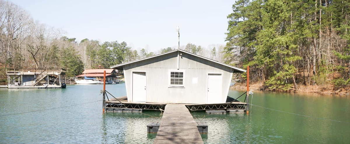 Three Boat houses, 1960's. 1980's, & New double deck w/ party roof on Lake Lanier in Burford Hero Image in undefined, Burford, GA