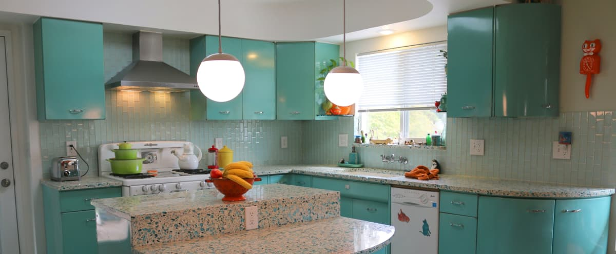 Colorful Retro Kitchen with Connected Eclectic Hipster Living Room or Den in Los Angeles Hero Image in Eagle Rock, Los Angeles, CA