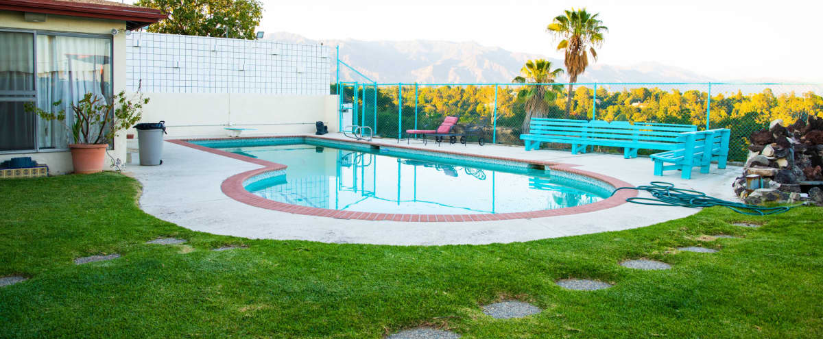 Huge Backyard with Pool, Bridge, Waterfall, Koi Fish pond, and a 1970s vibe with over 4,000 sq. ft. in Los Angeles Hero Image in Northeast Los Angeles, Los Angeles, CA