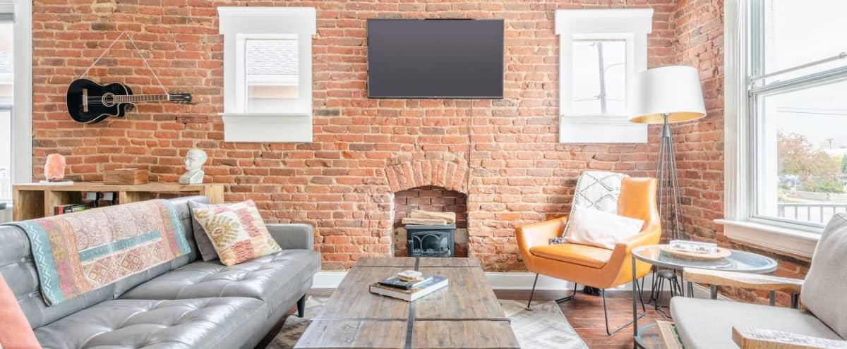 Hip Casita with Exposed Brick and Open Kitchen Floor Plan in Denver Hero Image in Baker, Denver, CO