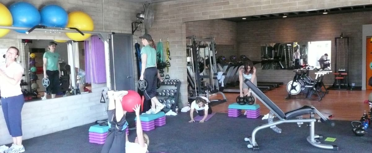 Fitness facility with a cool vibe built in an old mechanics garage with 2 huge garage doors. in PHOENIX Hero Image in Alhambra, PHOENIX, AZ