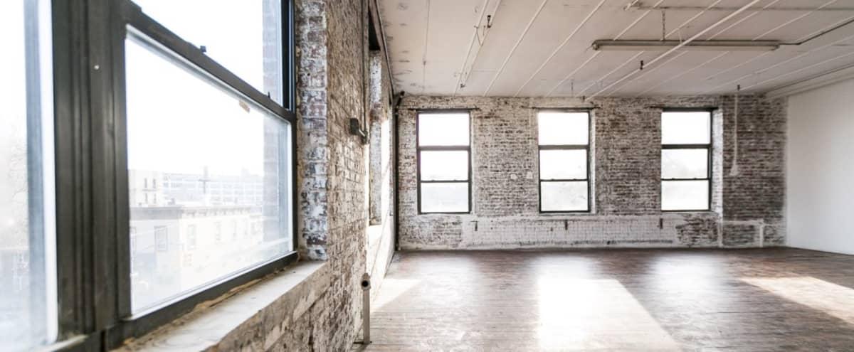 Exposed Brick Corner photo studio with lots of daylight and hardwood floors - Astoria 9 in Astoria Hero Image in Astoria, Astoria, NY