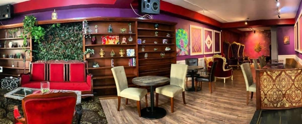 A Speakeasy Style Café Showcasing Beautiful Local Art with Low Light Lounge Tones in Parkland Hero Image in undefined, Parkland, WA