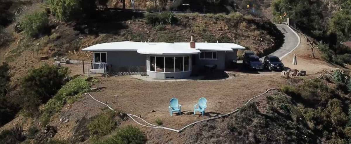 Hollywood hills two large flat pads of land with epic views and single story house in Los Angeles Hero Image in Hollywood Hills, Los Angeles, CA