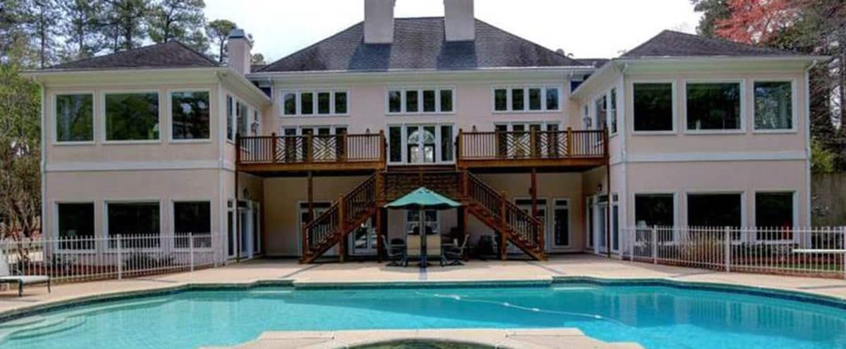 French Stucco Estate in 2 Acres of Lush, Ranch Style Views Great for Gatherings in Marietta Hero Image in undefined, Marietta, GA