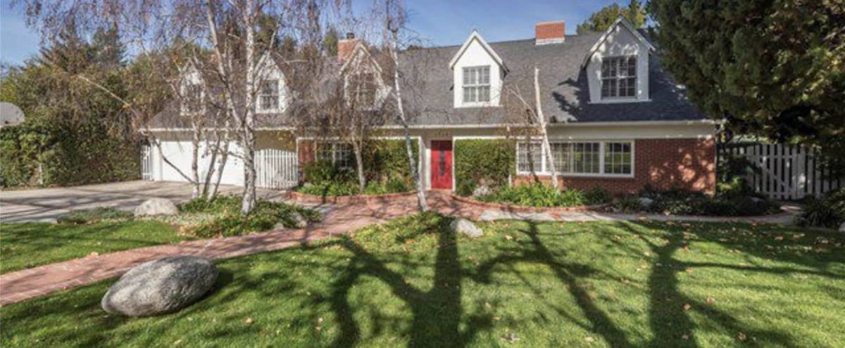 Stunning Traditional Cape Cod Home Sitting On One of the Best Streets in Vista De Oro in Woodland Hills Hero Image in Woodland Hills, Woodland Hills, CA