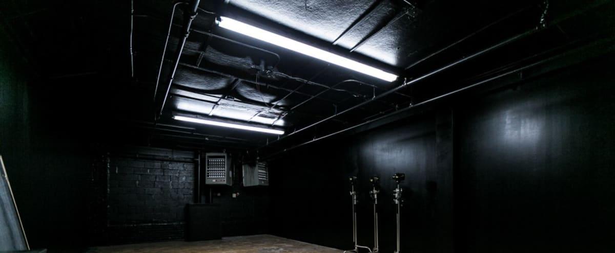 Blackout photo studio with black walls, black ceiling & hardwood floors  -  Astoria 4 in Astoria Hero Image in Astoria, Astoria, NY