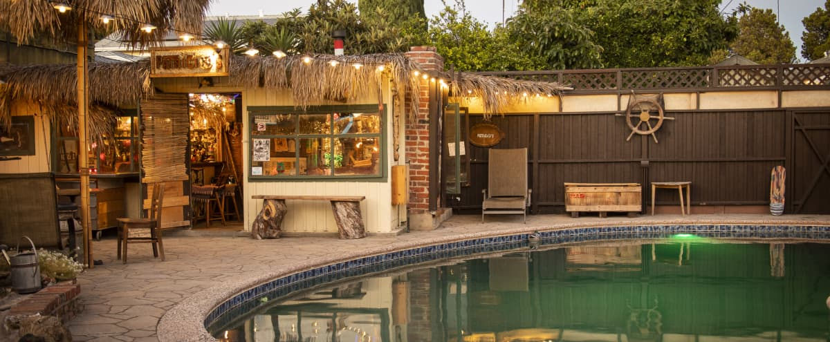 Vintage Backyard w Tiki Bar, Swimming Pool,  and Pond in Long Beach Hero Image in Rose Park, Long Beach, CA