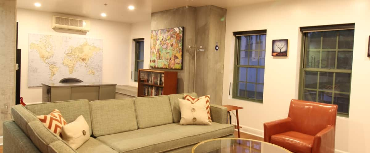 Downtown Historic Loft with City Views via Balcony and Exposed Concrete Walls in Los Angeles Hero Image in Central LA, Los Angeles, CA