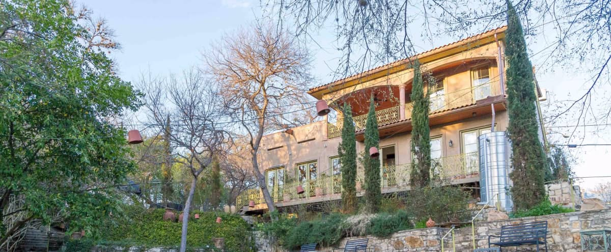 Enchanting 1-Acre Property: Historic House, Secret Gardens, Artist Cottage & Outdoor Amphitheater in Austin Hero Image in Old West Austin, Austin, TX
