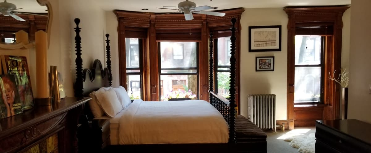 Charming Central Park Brownstone floor through apartment packed with original features - Lounge, 1 bedroom, balcony, 2 full bathrooms, kitchen. in New York Hero Image in Upper West Side, New York, NY
