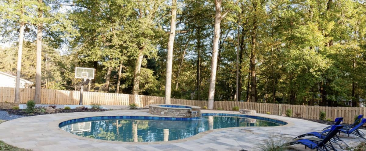 Backyard Oasis with swimming pool, hot tub, and basketball court in Smyrna Hero Image in undefined, Smyrna, GA