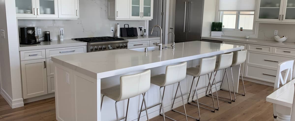White Bright Kitchen with Large Island in Pacific Beach in San Diego Hero Image in Pacific Beach, San Diego, CA