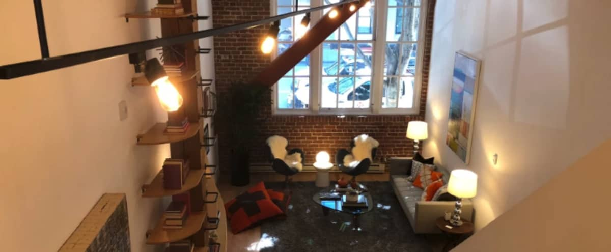 SOMA Brick Loft with one private room and large window for lighting in San Francisco Hero Image in South of Market, San Francisco, CA