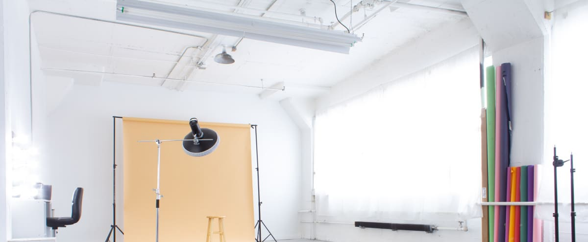 Best Downtown Natural Light Photo Studio - White Walls With Industrial Floors in Pontiac Hero Image in undefined, Pontiac, MI