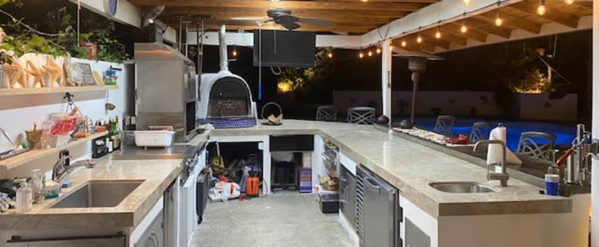 Great outdoor backyard with an amazing outdoor kitchen in Calabasas Hero Image in Greater Mulwood, Calabasas, CA