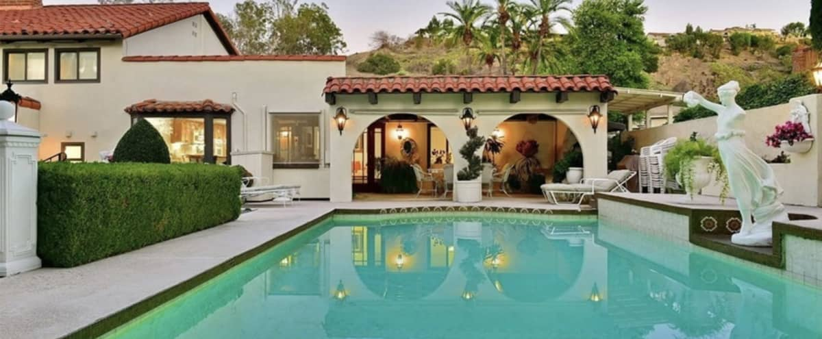 Versatile Spanish Beauty with Pool/Spa, Lush Greenery, and Glistening LA Views in West Covina Hero Image in Walnut Valley, West Covina, CA