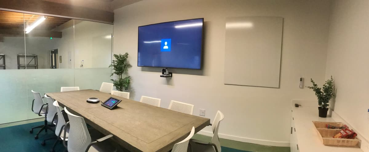 Modern, vibrant Conference Room space with TV, Whiteboard, and Video Conference Communication Technology in Berkeley Hero Image in Southwest Berkeley, Berkeley, CA