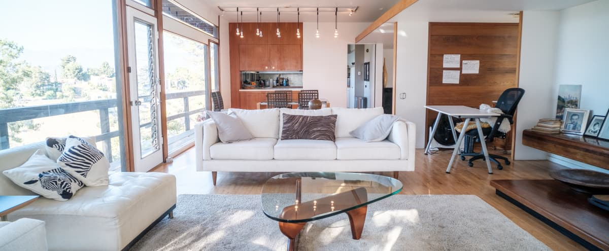 Classic Mid Century home, Views, Sunsets, Glass, White, and Paneled walls in Los Angeles Hero Image in Northeast Los Angeles, Los Angeles, CA