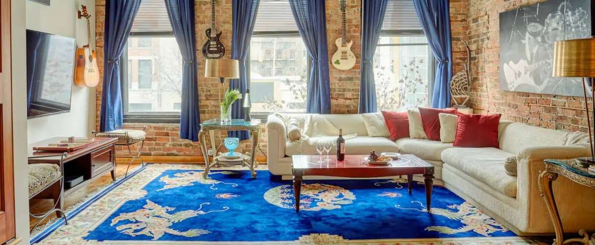 Legendary Guitar Designer's Apartment | Natural Light | Exposed Brick | Vintage Guitars and Artwork in Chicago Hero Image in Near North Side, Chicago, IL