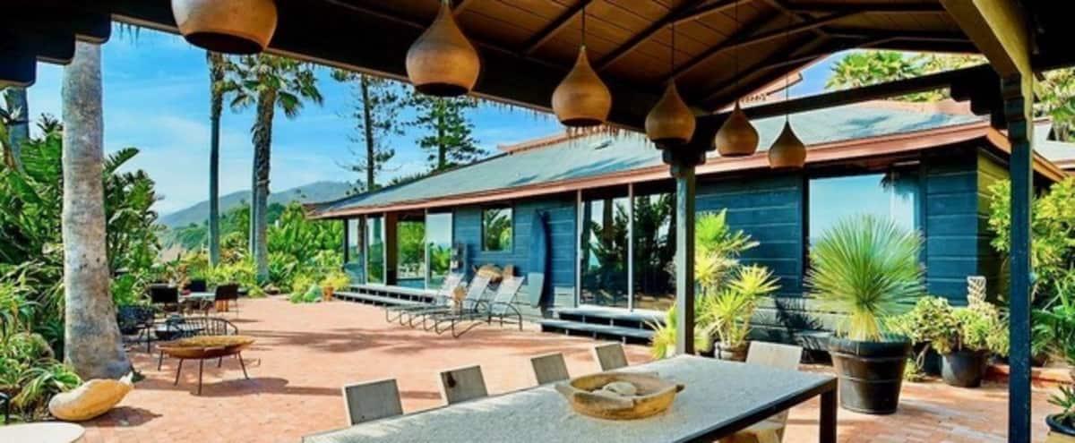 Private Designer Beach House next to Iconic County Line Beach. Large landscaped Yard and Patios in Malibu Hero Image in Malibu, Malibu, CA