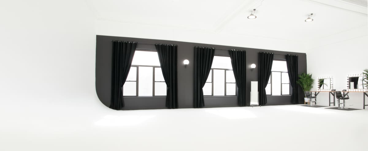 2000sq ft 40 ft Cyclorama Sun-Drenched White Studio W/ SkyBox DJ Booth in Brooklyn Hero Image in Greenpoint, Brooklyn, NY