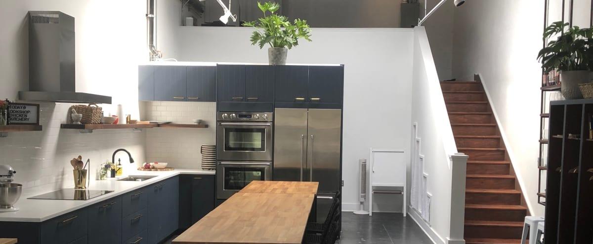 Light filled kitchen studio in SE Portland. Urban, industrial feel with modern kitchen layout and appliances. in Portland Hero Image in Southeast Portland, Portland, OR