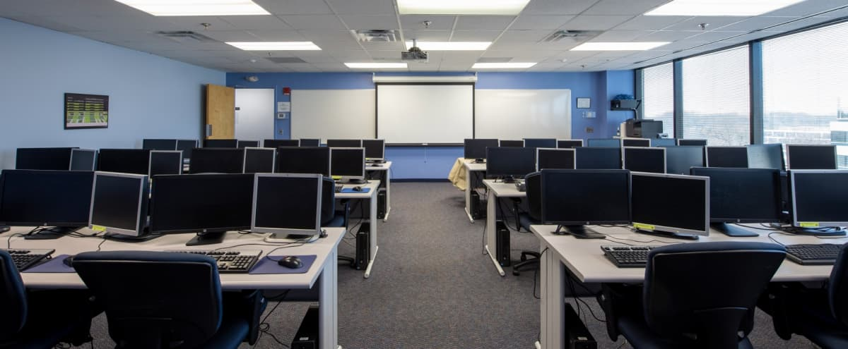 Dual-Monitor Classroom Style Training Room for Large Groups in Columbia Hero Image in Town Center, Columbia, MD