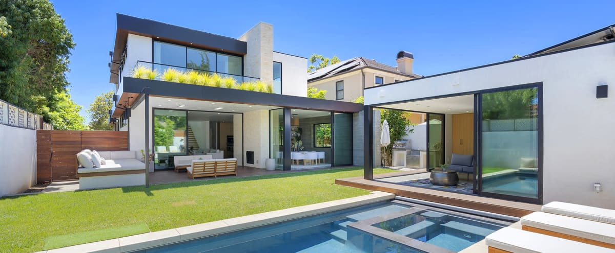 Modernist home with pool, roof deck, & 2 kitchens in Santa Monica Hero Image in North of Montana, Santa Monica, CA