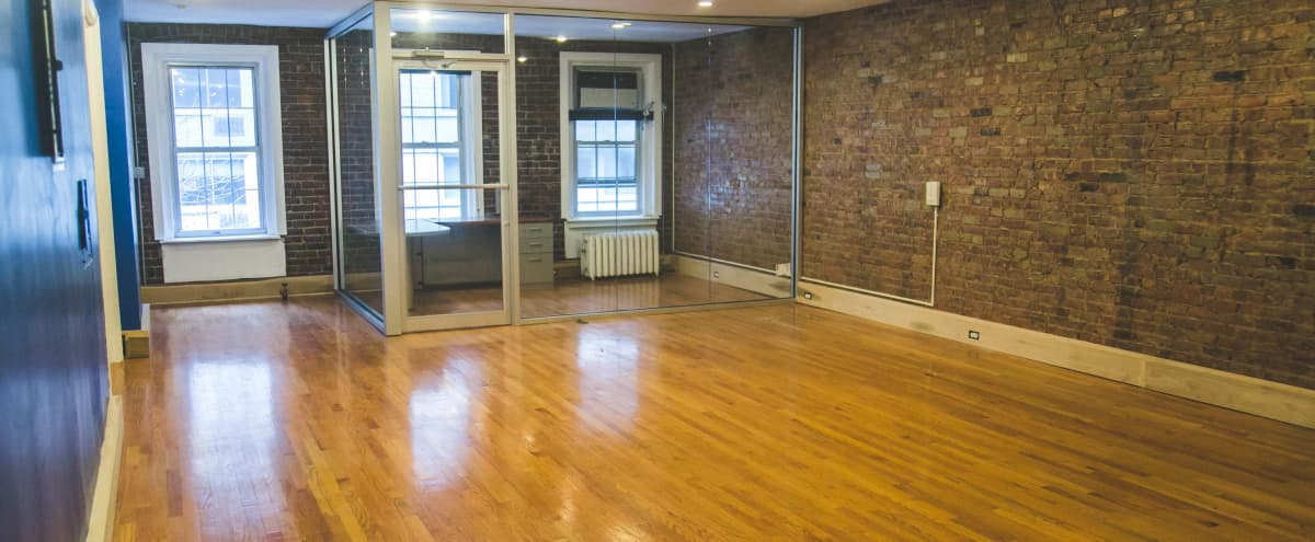 Open Office Space With Exposed Brick and Freight Elevator in New York Hero Image in Midtown Manhattan, New York, NY