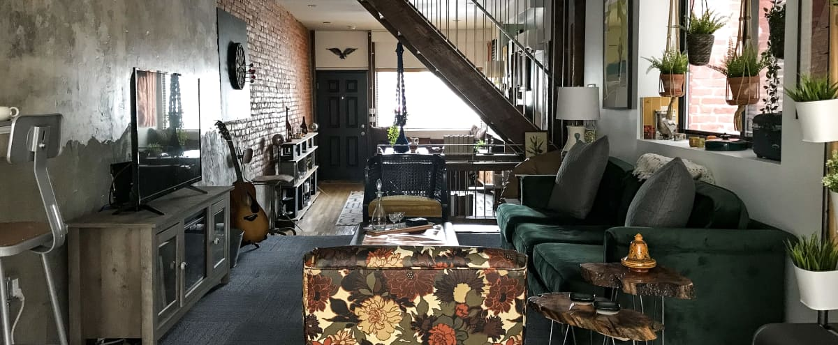 Renovated storefront row house with raw, industrial character & Americana-inspired design — great for film productions, photo shoots, & content creation in Philadelphia Hero Image in Poplar, Philadelphia, PA