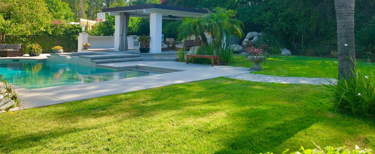 Myoka House; a zen- like outdoor space with Pergola, Pool, Water features, Fire pit and more in Northridge Hero Image in Northridge, Northridge, CA