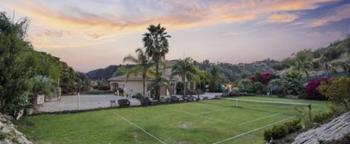 Charming Home with Gorgeous Backyard & Grass Tennis Court in Topanga Hero Image in undefined, Topanga, CA
