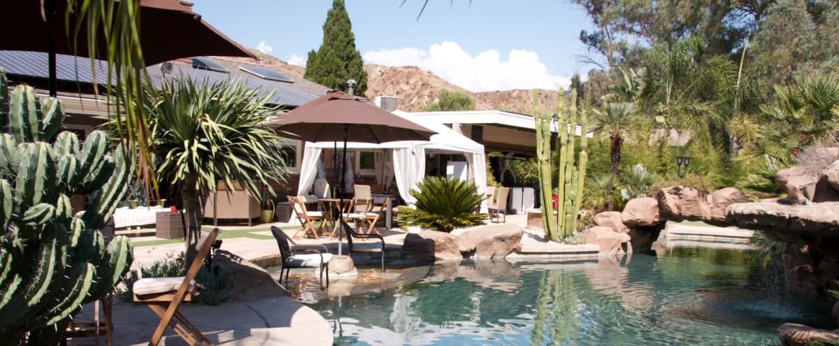 Contemporary Ranch house on 3/4 acre lot with lagoon style pool area and tropical backyard in San Valley Hero Image in Sun Valley, San Valley, CA