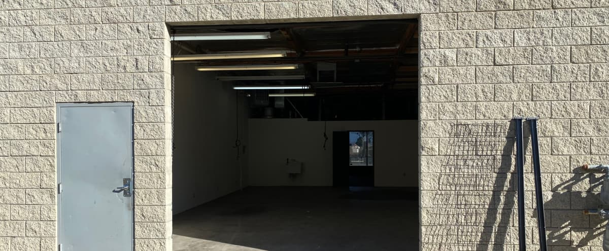 Warehouse in the High Desert with large roll up door and front office in Palmdale Hero Image in undefined, Palmdale, CA