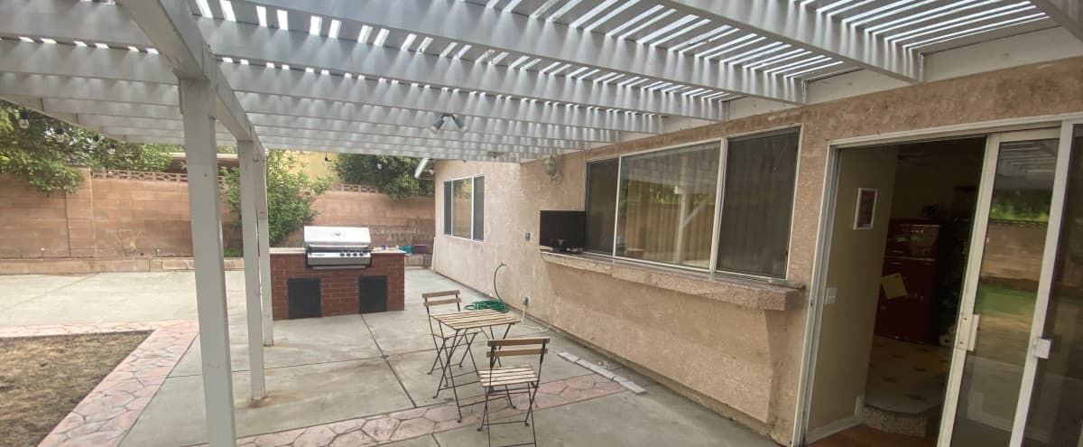 Spacious Backyard with Cute Dollhouse - Cookout scenes, family reunions, photoshoots in Granada Hills Hero Image in Granada Hills, Granada Hills, CA