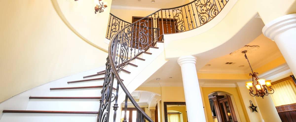 Mediterranean / Spanish Villa in Santa Monica with Hardwood Spiral Staircase, Cast Iron Railing in Santa Monica Hero Image in Mid-City, Santa Monica, CA