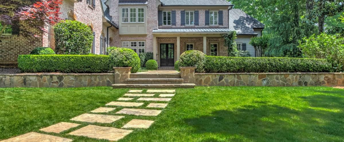 Custom Brick Estate, Rose Garden w/ lush view of private forest. Heart of Atlanta in Atlanta Hero Image in Buckhead, Atlanta, GA