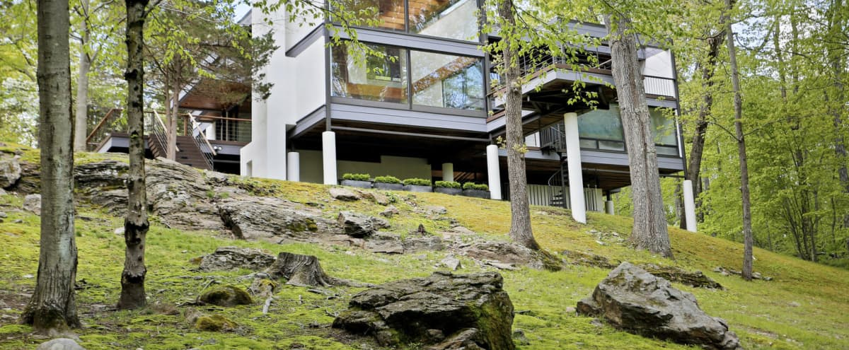Modern glass house nestled on 18 wooden acres with pool, pond and tons of outdoor decks in Easton Hero Image in undefined, Easton, CT