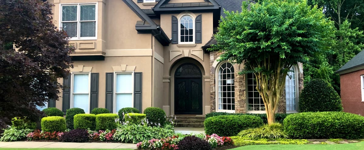 This picture perfect transitional-styled home is nestled within a tree-lined and immaculate suburban oasis. in Roswell Hero Image in null, Roswell, GA