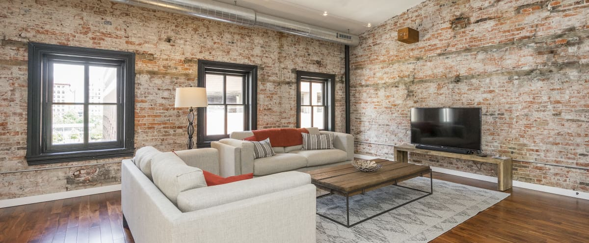 Designer Loft with Exposed Brick in City Center in Philadelphia Hero Image in Center City East, Philadelphia, PA