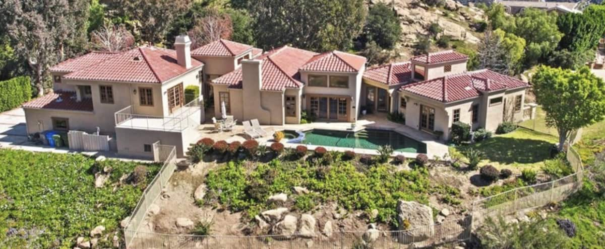 Beautiful Tuscan style estate with exceptional canyon views in every room *FILMING ONLY* in Bell Canyon Hero Image in undefined, Bell Canyon, CA