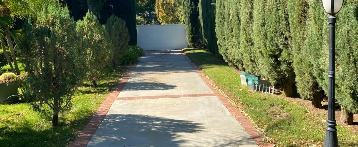 Luscious Manicured  Front Yard with Circular Driveway in Van Nuys Hero Image in Lake Balboa, Van Nuys, CA